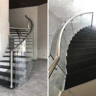 Лестница на центральном косоуре с гнутым стеклянным ограждением.